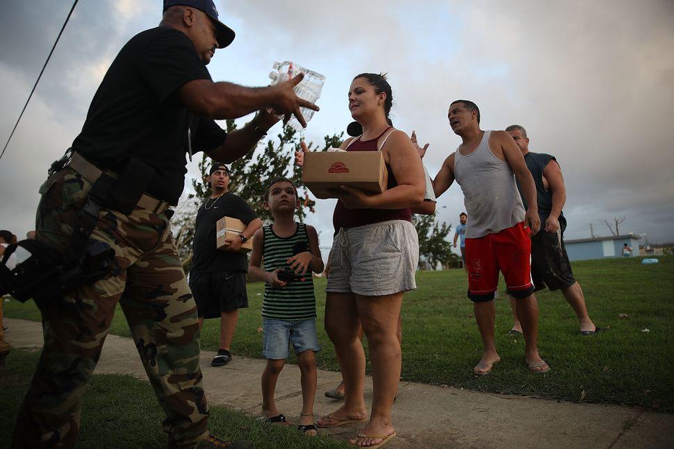Hurricane survivors receive supplies on Sept. 28, 2017 in Toa Baja, Puerto Rico.