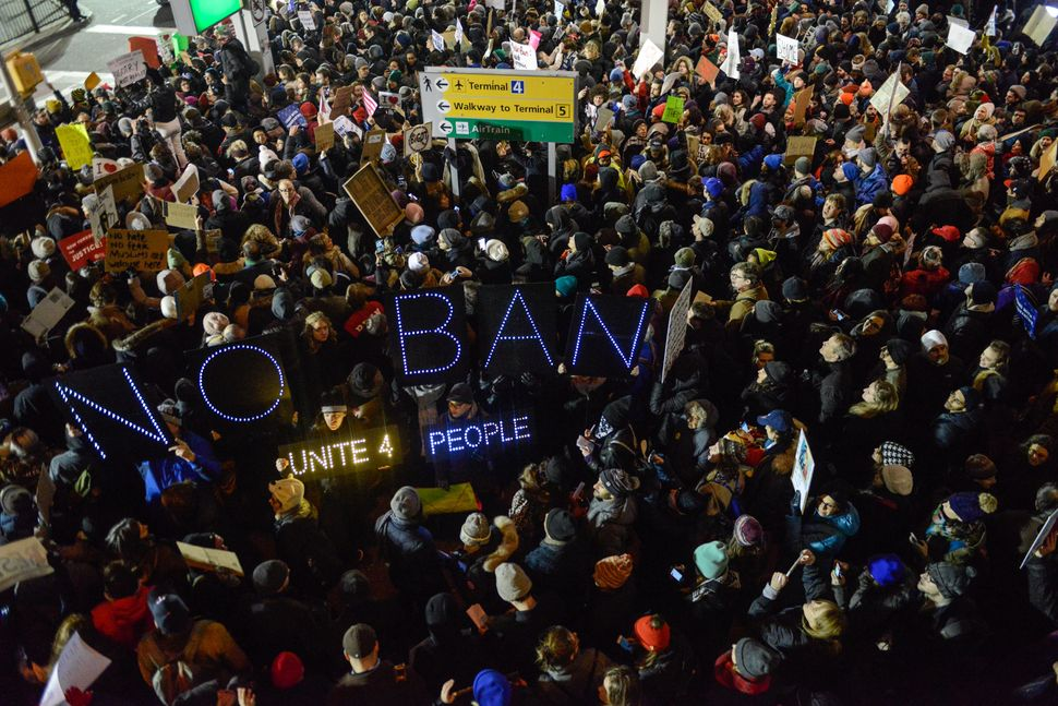 Protesters rally against Donald Trump's travel ban at John F. Kennedy International Airport in New York City on Jan. 28, 2017