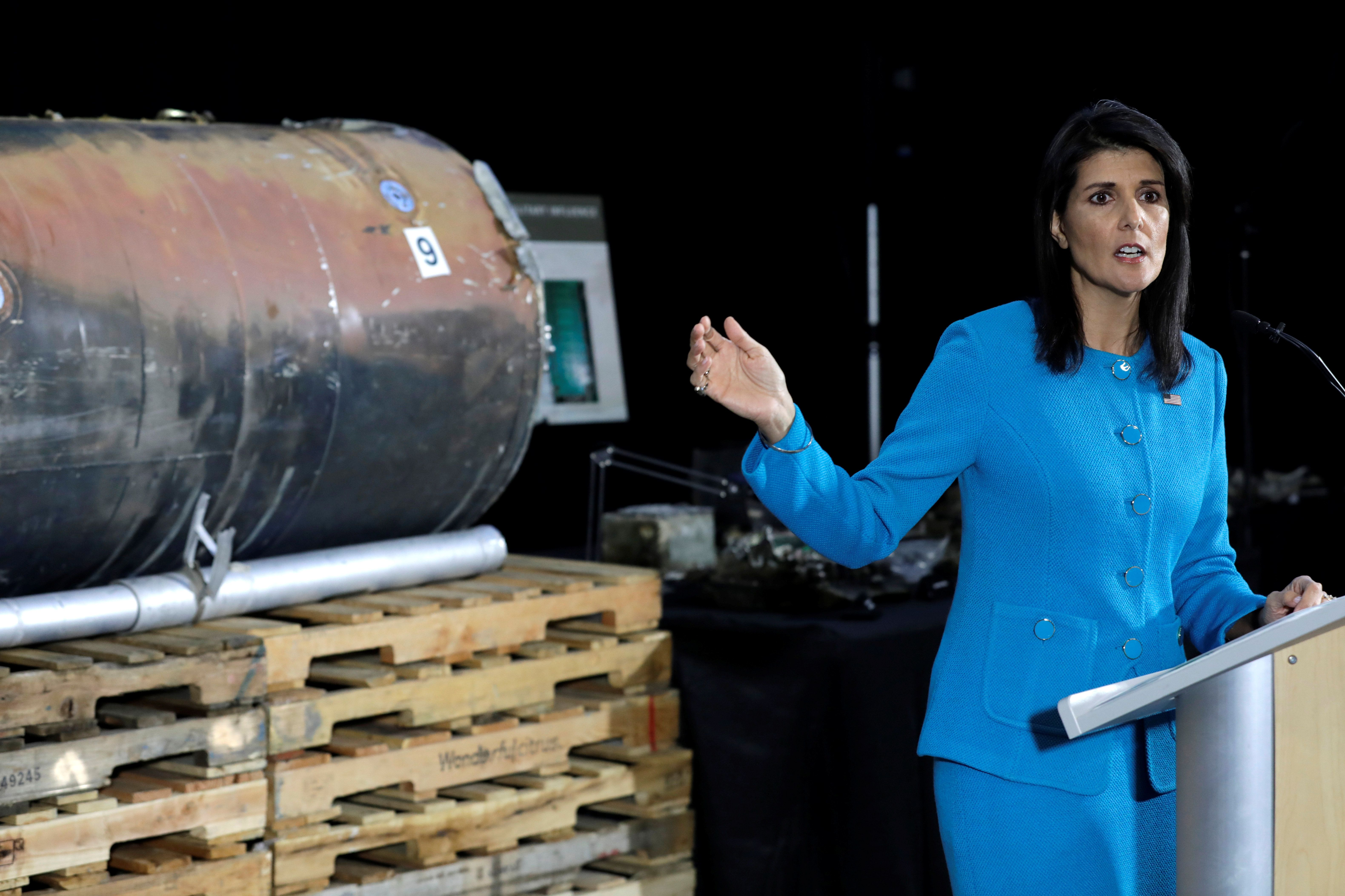 """U.S. Ambassador to the United Nations Nikki Haley briefs the media in front of remains of Iranian """"Qiam"""" ballistic missile provided by Pentagon at Joint Base Anacostia-Bolling in Washington, U.S., December 14, 2017. REUTERS/Yuri Gripas"""