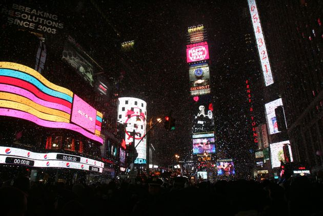 Revelers celebrate the new year in Times Square moments after the ball dropped on Jan. 1,
