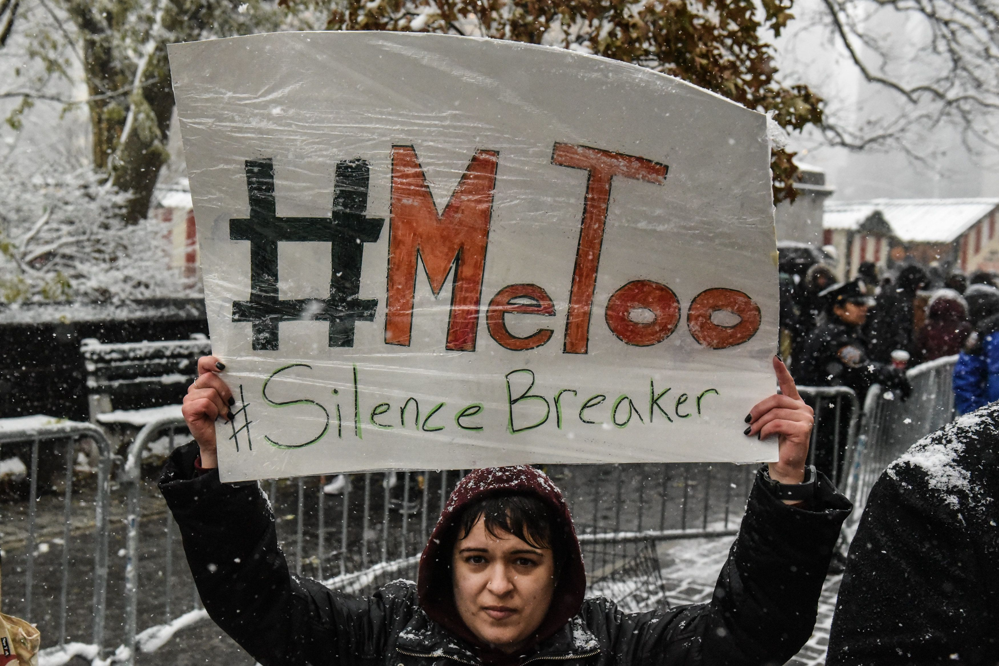 NEW YORK, NY - DECEMBER 09: People carry signs addressing the issue of sexual harassment at a #MeToo rally outside of Trump International Hotel on December 9, 2017 in New York City. (Photo by Stephanie Keith/Getty Images)