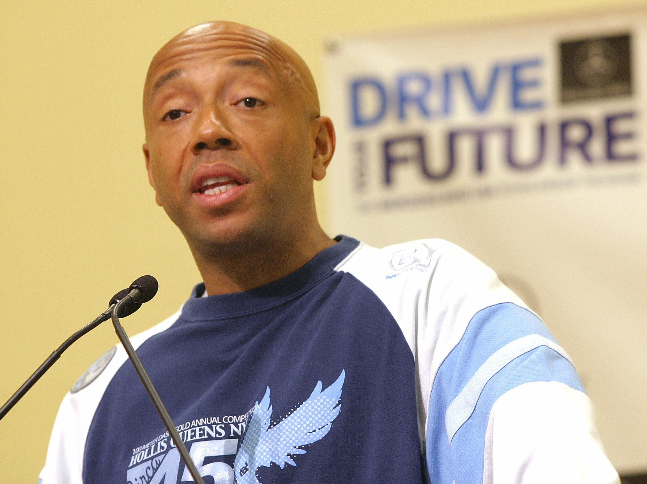Entrepreneur Russell Simmons speaks at a Young Women's Leadership School in East Harlem, the only all girls' public school in New York, on May 26, 2004. Simmons, Young Women's Leadership School Students and Mercedes-Benz USA celebrated National Scholarship Month with a new national scholarship program currently accepting applications. A total of $500,000 in scholarships will be awarded this year for college bound seniors nationwide who are the first in their families to attend college. REUTERS/Anders Krusberg  AF