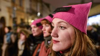 People gather outside the U.S. Consulate General on Stolarska Street in Krakow this evening during the Womens March on Washington. On Saturday, 21 January 2017, in Krakow, Poland. (Photo by Artur Widak/NurPhoto via Getty Images)