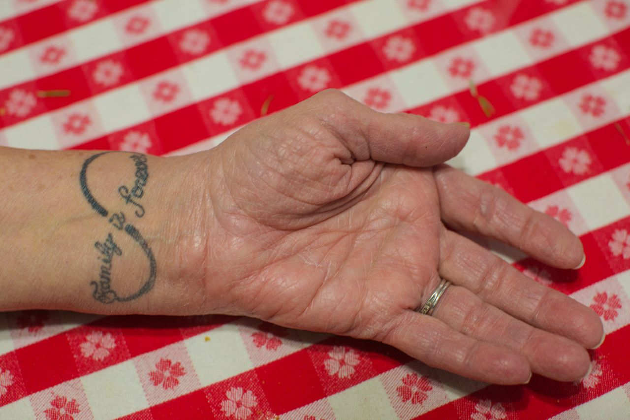 """Doris Thompson, 74, Sunnie's guardian, shows a tattoo she got four years ago that says, """"Family is forever."""""""