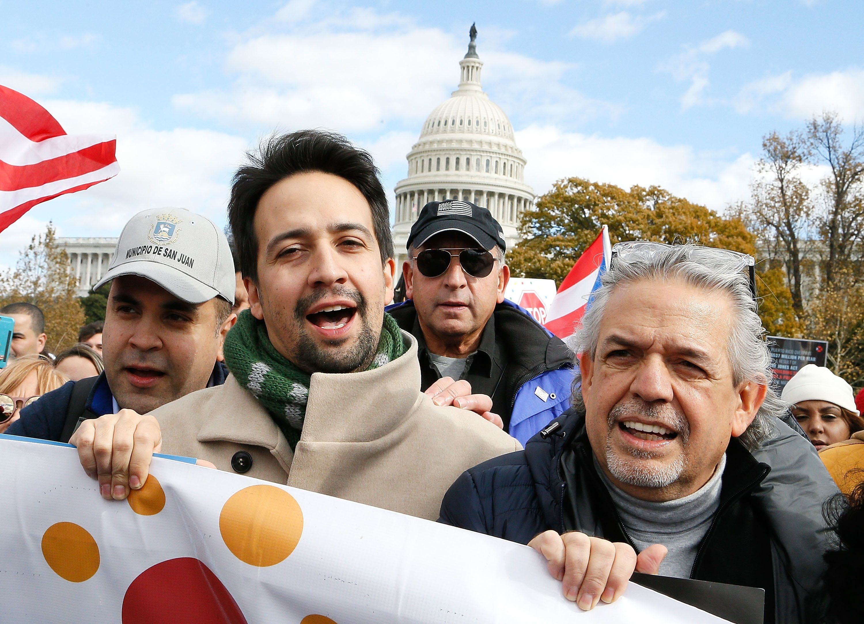 WASHINGTON, DC - NOVEMBER 19:  Lin-Manuel Miranda (C) and his father, Luis A. Miranda Jr. (R), attend a Unity for Puerto Rico march on Capitol Hill on November 19, 2017 in Washington, DC.  (Photo by Paul Morigi/Getty Images)