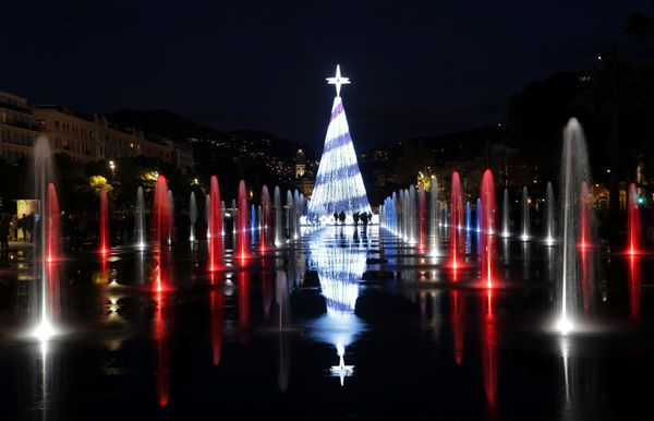An illuminated Christmas tree and fountains are seen in Nice, France, on Dec. 3, 2017.