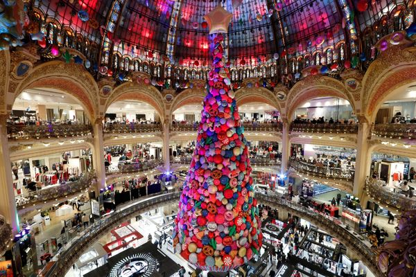 A giant Christmas tree stands in the Galeries Lafayette department store in Paris, France.