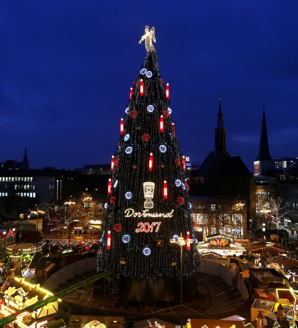 A giant Christmas tree sits in the middle of a Christmas market in Dortmund, Germany.