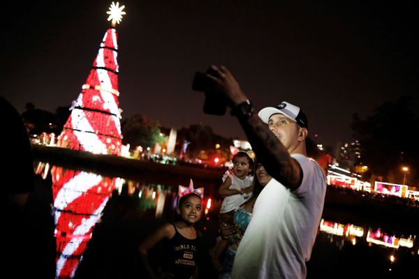 A family takes a sefie during the launch of the Ibirapuera Park Christmas tree in the city of Sao Paulo, Brazil.