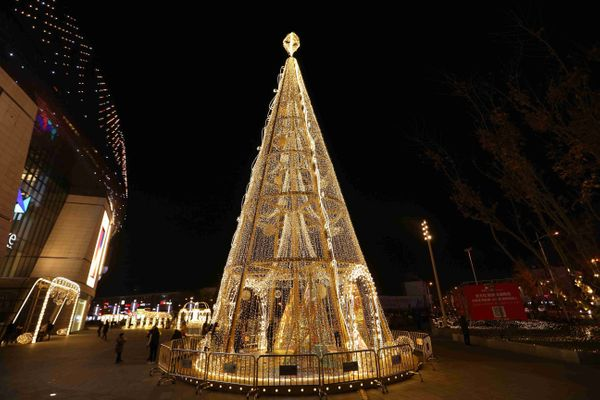 A 22-meter Christmas tree with golden LEDs sits in the Qibao Ancient Town in Shanghai, China.