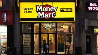 DOWNTOWN, TORONTO, ONTARIO, CANADA - 2015/08/23: People walking in front of a Money Mart store in Toronto. National Money Mart Company, commonly known as Money Mart, is a Canadian financial services company that provides payday loans, cheque cashing, tax preparation and money transfer services to the underbanked. (Photo by Roberto Machado Noa/LightRocket via Getty Images)
