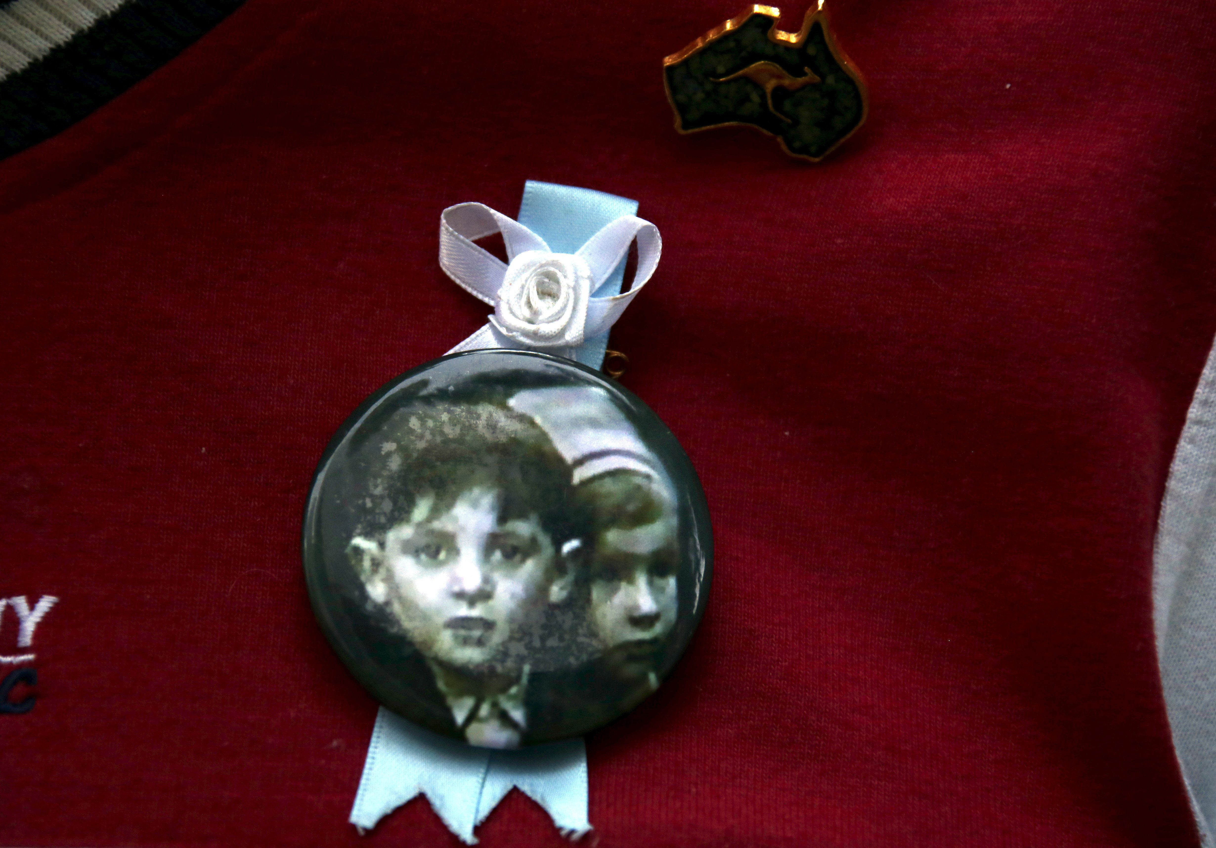 "A relative wears a pin displaying a photograph of children who he said had been sexually abused by the Catholic Church as he stands outside the venue for Australia's Royal Commission into Institutional Response to Child Sexual Abuse in Sydney, Australia, February 29, 2016. Australian Cardinal George Pell said on Sunday the Catholic Church had made ""enormous mistakes"" as he became the highest-ranking Vatican official to testify on sexual abuse of children in the Church. Pell, 74, held up a Bible as he was sworn in to answer questions by Australia's Royal Commission into Institutional Response to Child Sexual Abuse in front of victims in a Rome hotel room. REUTERS/David Gray"