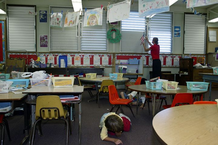 In this file photo from 2003, students in Hawaii participate in a classroom lockdown drill.