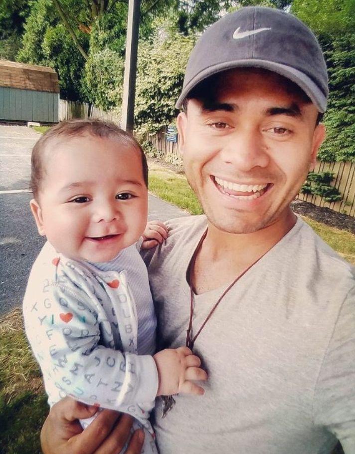 Osman Aroche Enriquez with his son