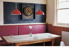 <p>Keeping it simple, a table set for service at The Sportsman</p>
