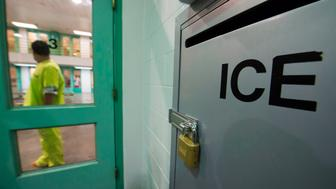An immigration detainee stands near an US Immigration and Customs Enforcement (ICE) grievance box in the high security unit at the Theo Lacy Facility, a county jail which also houses immigration detainees arrested by the US Immigration and Customs Enforcement  (ICE), March 14, 2017 in Orange, California, about 32 miles (52km) southeast of Los Angeles.  US President Donald Trumps first budget provides more than USD 4.5 billion in new spending to fight illegal immigration by adding immigration and border enforcement agents, prosecutors and judges, as well as building a wall on the border with Mexico. / AFP PHOTO / Robyn Beck        (Photo credit should read ROBYN BECK/AFP/Getty Images)