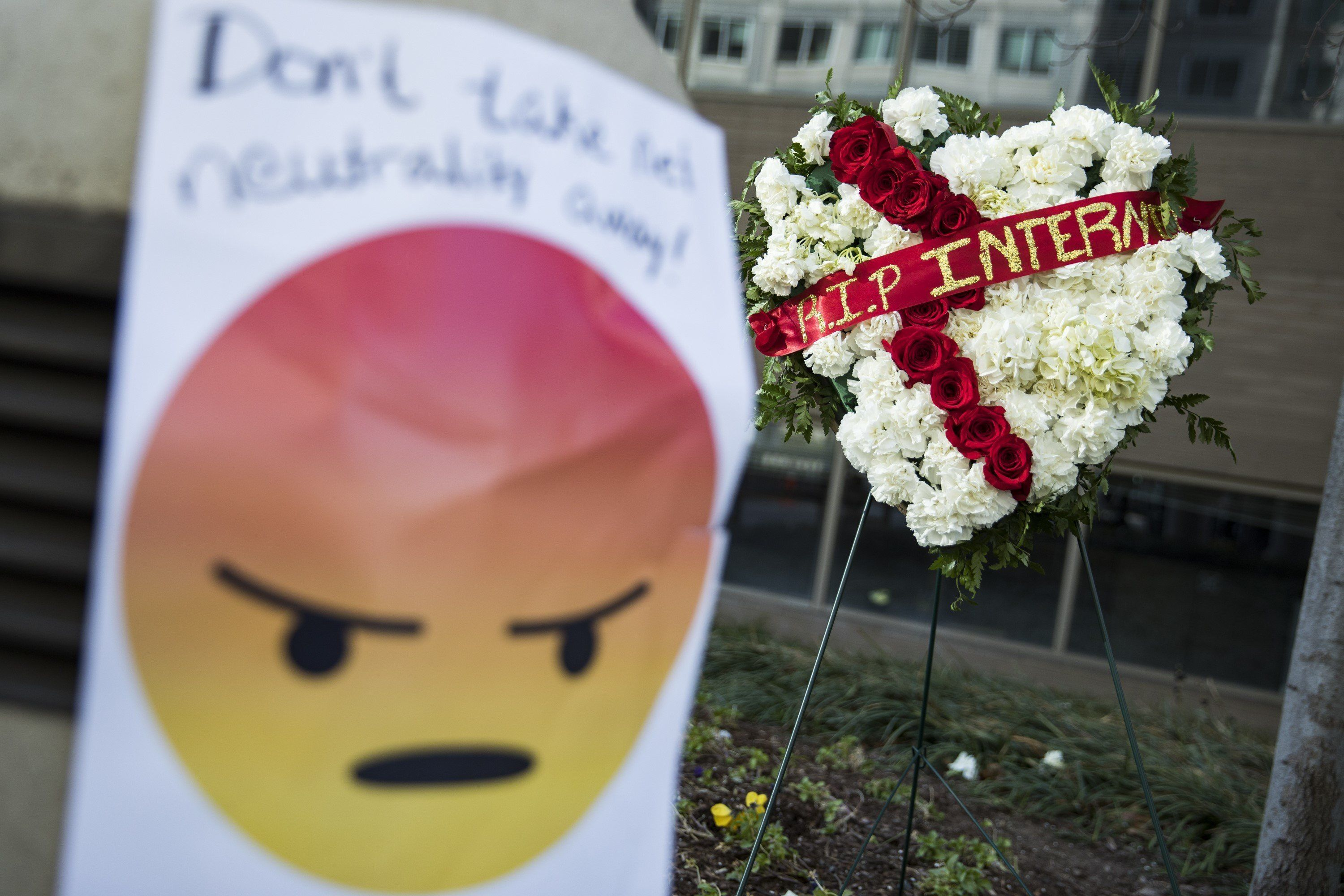 WASHINGTON, USA - December 14: Protestors laid flowers and notes outside of the Federal Communications Commission (FCC) headquarters after the FCC repealed the Obama era regulations protecting Net Neutrality in Washington, USA on December 14, 2017. (Photo by Samuel Corum/Anadolu Agency/Getty Images)