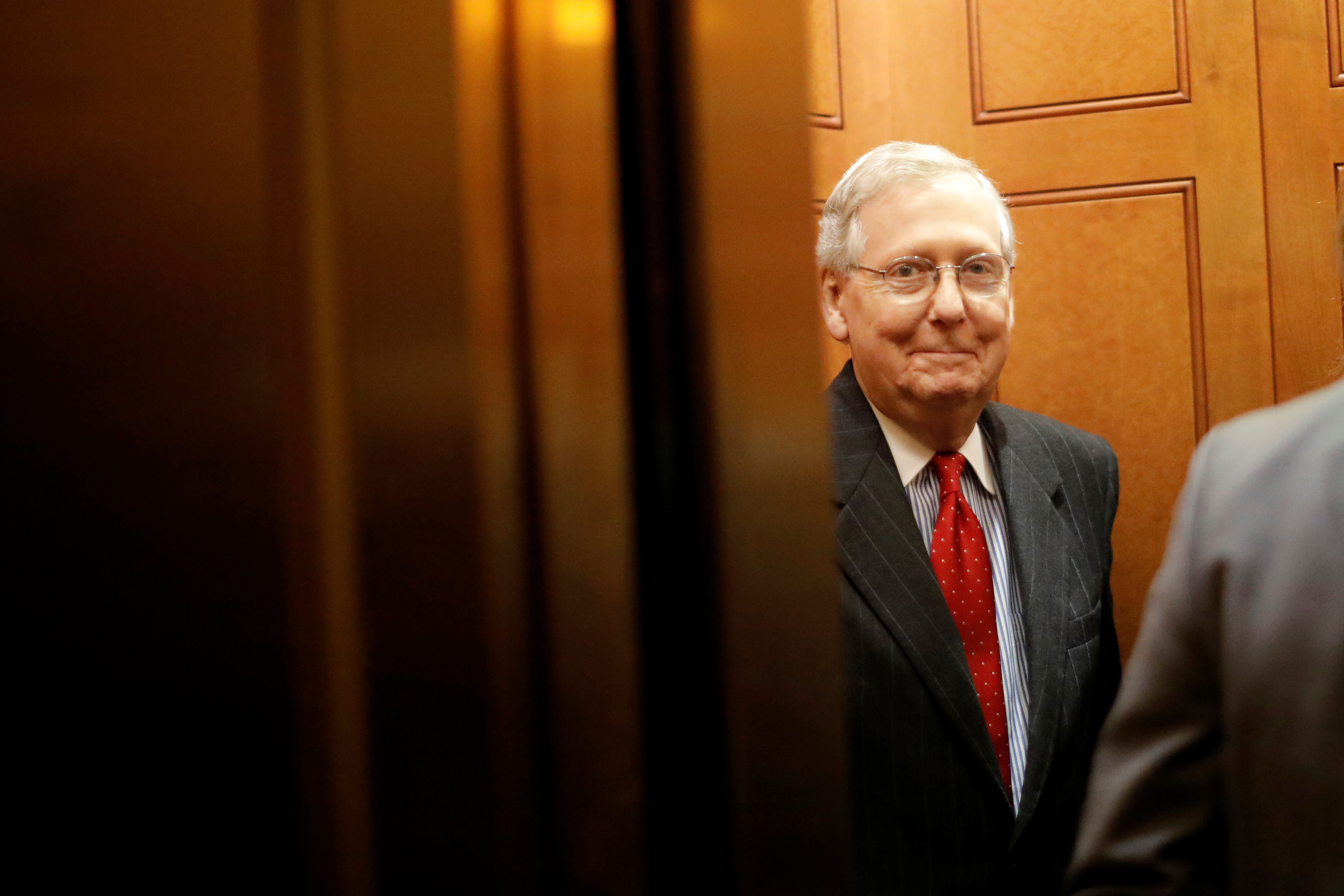 Senate Majority Leader Mitch McConnell (R-KY) smiles as he leaves the Republicans weekly policy luncheon on Capitol Hill in Washington, U.S., November 28, 2017. REUTERS/Carlos Barria