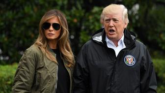 WASHINGTON D.C., Aug. 29, 2017 -- U.S. President Donald Trump (R) and First Lady Melania Trump walk to board Marine One before departing the White House for Joint Base Andrews, en route to Corpus Christi, Texas, in Washington, D.C., the United States, on Aug. 29, 2017. President Donald Trump went to Texas on Tuesday to see the recovery efforts underway in the aftermath of Hurricane Harvey. (Xinhua/Yin Bogu via Getty Images)
