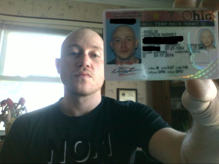 Andrew Anglin displays an Ohio state identification card from 2013.