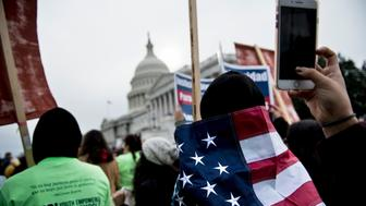 People protesting the cancellation of the Deferred Action for Childhood Arrivals rally outside the Capitol Building on Capitol Hill December 6, 2017 in Washington, DC. / AFP PHOTO / Brendan Smialowski        (Photo credit should read BRENDAN SMIALOWSKI/AFP/Getty Images)