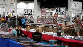 Dealers sit at their booths during the Guntoberfest gun show in Oaks, Pennsylvania, U.S., October 6, 2017.   REUTERS/Joshua Roberts