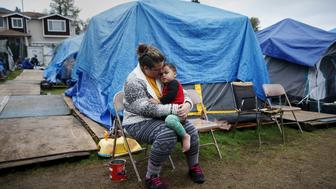 Kadee Ingram, 28, holds her son Sean, 2, at SHARE/WHEEL Tent City 3 outside Seattle, Washington October 13, 2015.    REUTERS/Shannon Stapleton/File Photo        GLOBAL BUSINESS WEEK AHEAD PACKAGE - SEARCH 'BUSINESS WEEK AHEAD MAY 30'  FOR ALL IMAGES