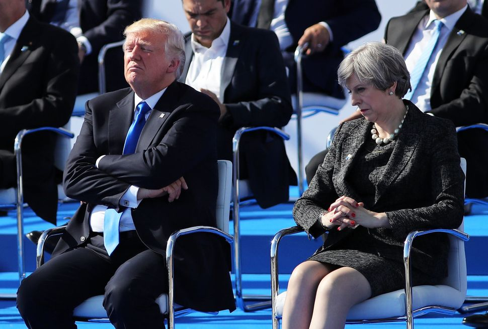 Trump and British Prime Minister Theresa May are pictured ahead of a photo opportunity of leaders as they arrive for a NATO s
