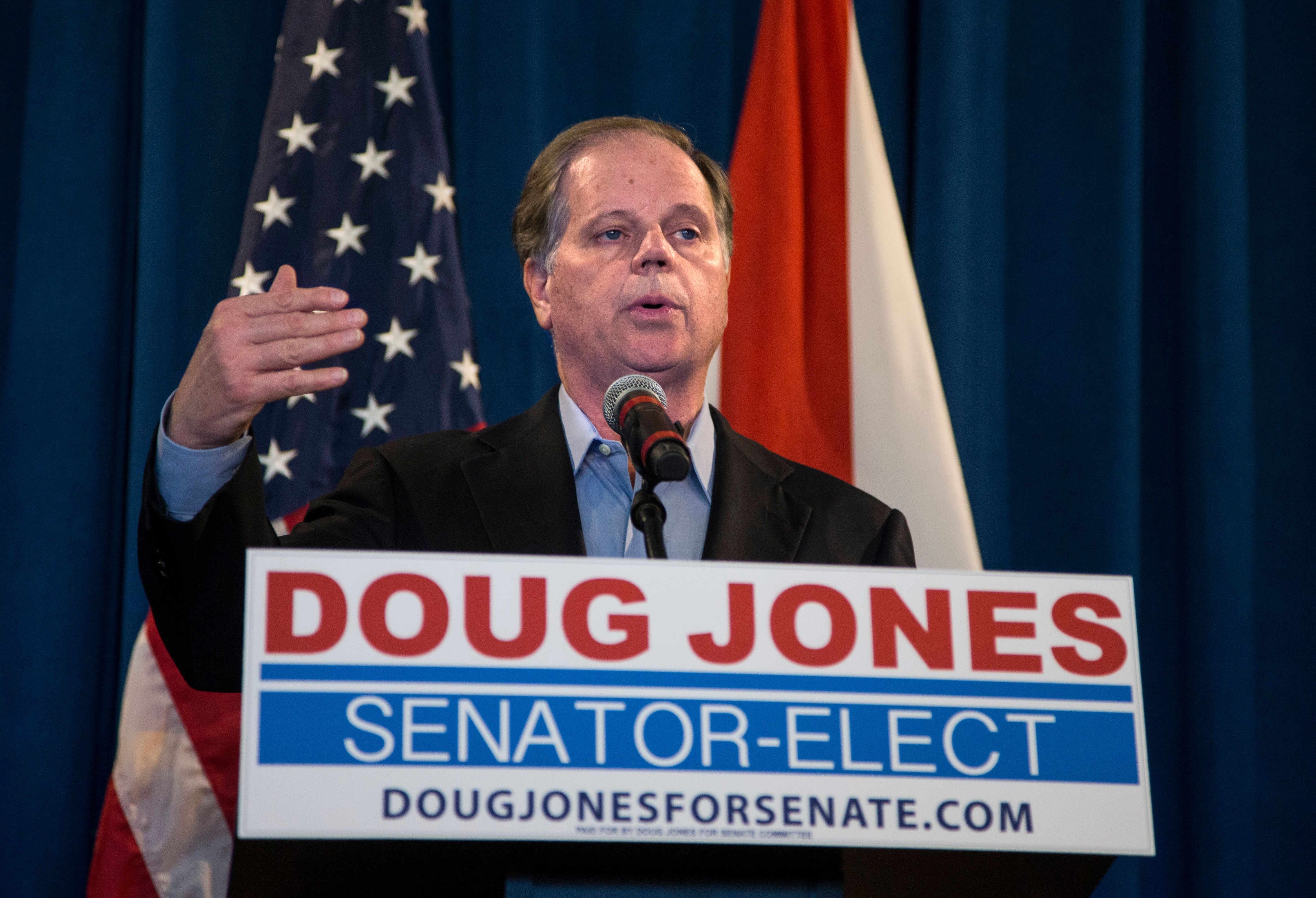 Senator-elect Doug Jones (D-Ala.) speaks to reporters on Dec. 13, 2017, the day after his upset victory in a special election