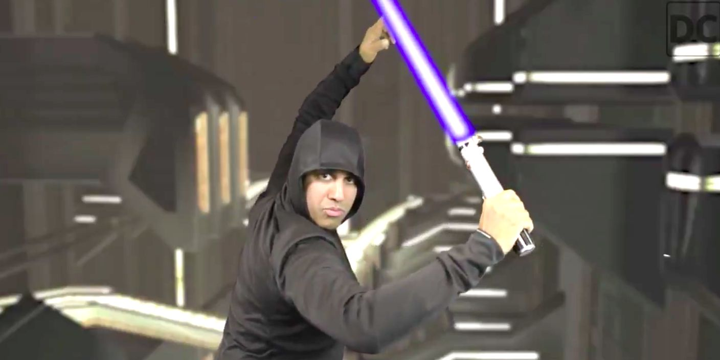 FCC chairman Ajit Pai poses with a light saber