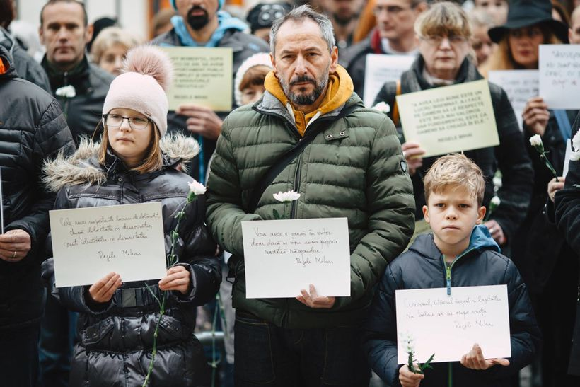 Sibiu, Romania. Silent protesters hold up sheets of paper with quotes from late King Michael's speeches and texts.