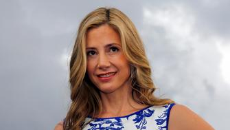 """Actress Mira Sorvino poses during a photocall for the television series """"Intruders"""" during the annual MIPCOM television programme market in Cannes, October 13, 2014. REUTERS/Eric Gaillard (FRANCE - Tags: ENTERTAINMENT MEDIA)"""