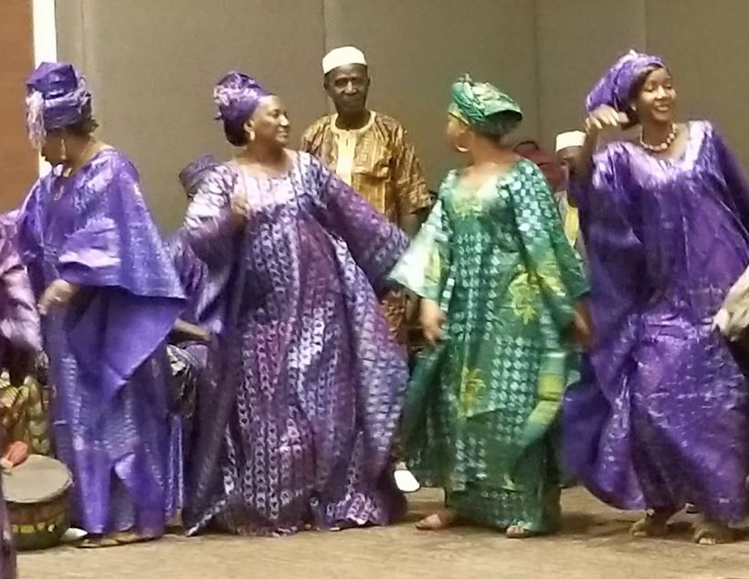 Guinean women dance at the opening of the Ouagadougou Partnership 6th annual meeting in Conakry, Guinea