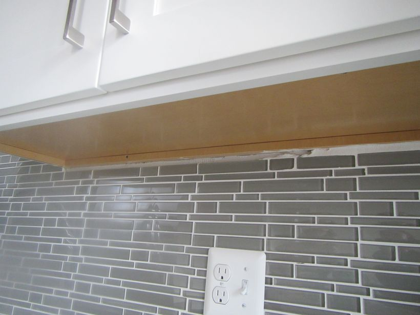 Unfinished Backsplash; Outlet should be GFI as this is next to the sink.