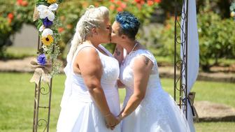 SYDNEY, AUSTRALIA - DECEMBER 16:  Same-sex couple Amy Laker and Lauren Price kiss during their wedding ceremony on December 16, 2017 in Sydney, Australia. Lauren and Amy are the first gay couple to be legally married in Australia, after same-sex marriage was legalised on 9 December 2017. The women - who have been engaged for two years - had originally planned on having a civil union, but were granted an exemption to the 30-day notice period to make their union legally binding under the new laws.  (Photo by Caroline McCredie/Getty Images)