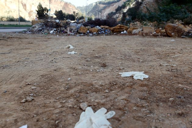 Gloves are seen on the ground at the scene where Dykes was