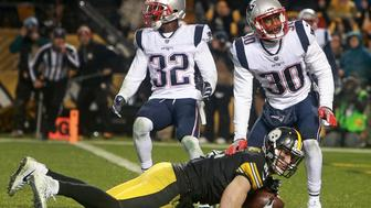 PITTSBURGH, PA - DECEMBER 17:  New England Patriots Devin McCourty (32) and Duron Harmon (30) look for a call after Pittsburgh Steelers tight end Jesse James, left, lunged over the goal line during the fourth quarter of a game against the New England Patriots at Heinz Field in Pittsburgh, Pa., Dec. 17, 2017. After official review, it was ruled an incomplete pass. (Photo by Jim Davis/The Boston Globe via Getty Images)