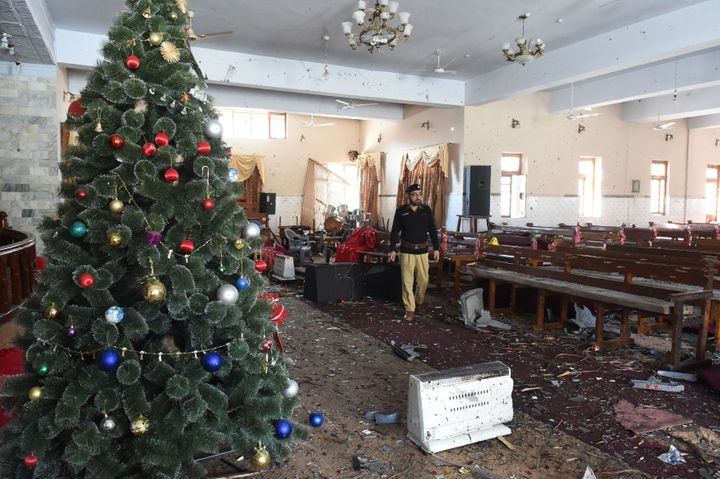A Pakistani investigator collect evidence a day after a suicide attack in the Methodist Church in Quetta on December 18, 2017