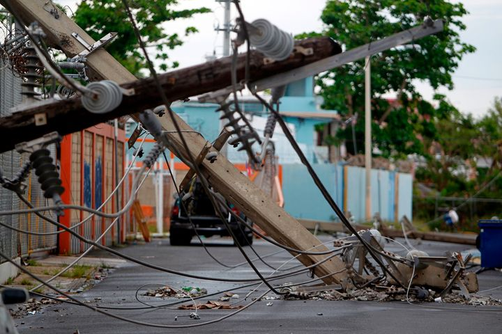 Powerline poles that were toppled by the Category 4 storm are seen in a San Juan street on Nov. 7, nearly two month