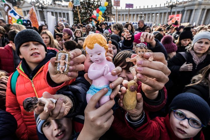 Following a custom started by the late Pope John Paul II, Pope Francis blessed Nativity figurines brought by pilgrims on Dec.