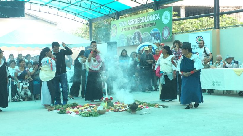 """An offering to Pachamama during the inauguration of this pictured space for use in a weekly """"farmer's market"""""""