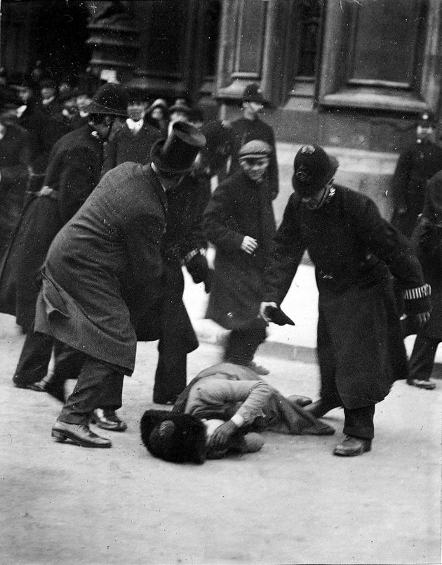 Believed to be suffragette Mrs Ernestine Mills, and Dr Herbert Mills in top hat, Black Friday demonstration,...
