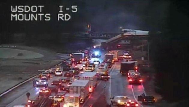 An Amtrak passenger train in seen derailed on a bridge in Washington
