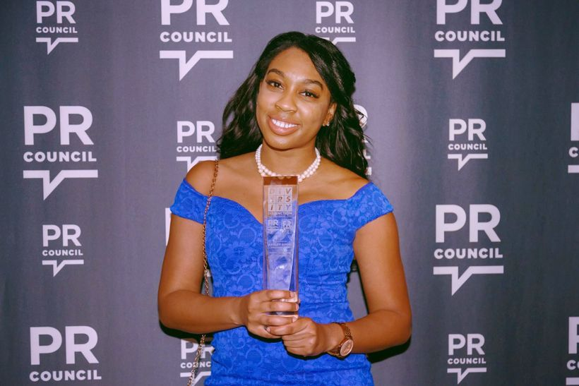 Ashley Simms accepting the Outstanding Young Professional Award at the 2017 Diversity Distinction in PR Awards