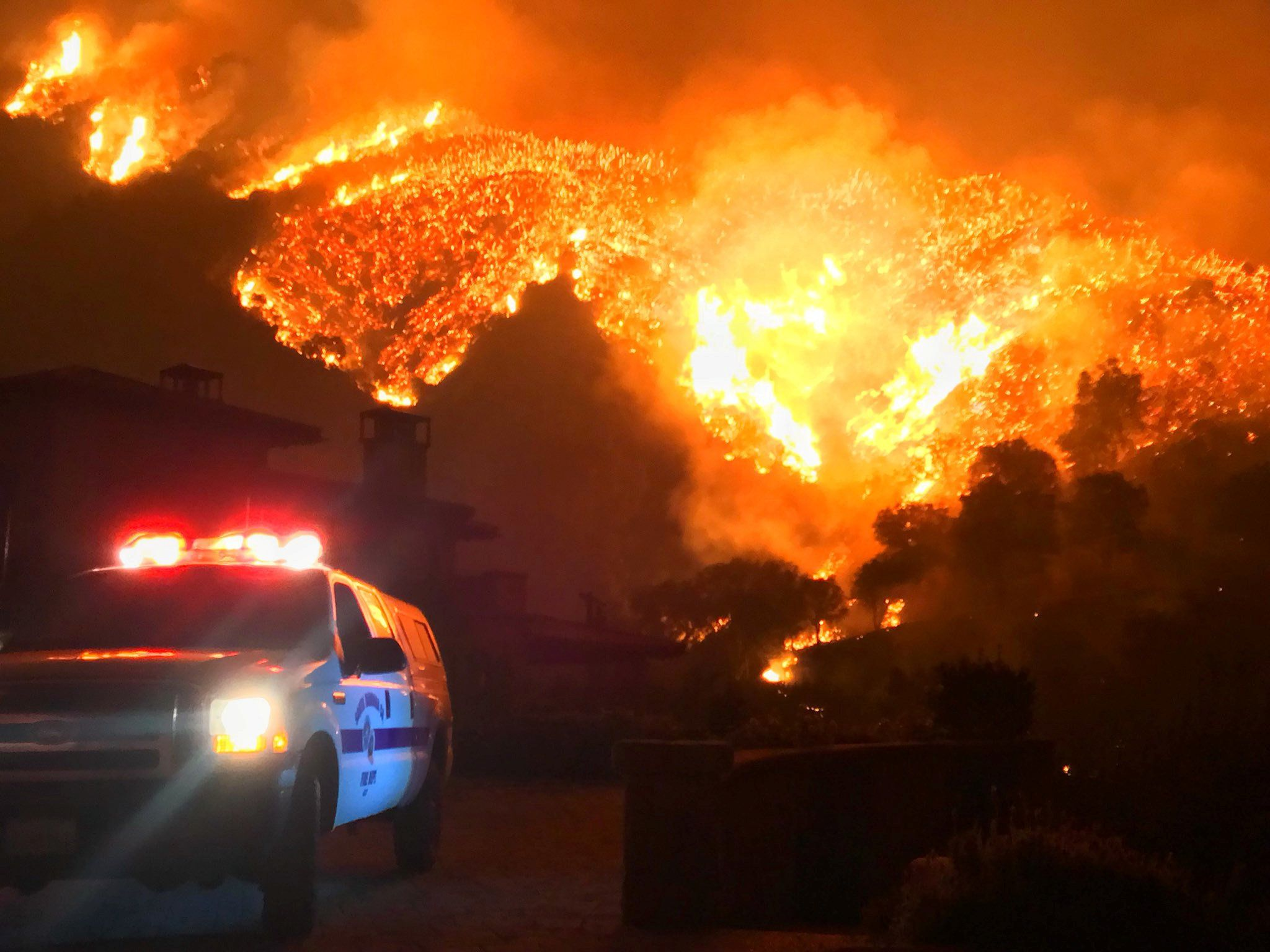 Thomas wildfire burns above Bella Vista Drive near Romero Canyon in this social media photo by Santa Barbara County Fire Department in Montecito, California, U.S. December 12, 2017.  Courtesy Mike Eliason/Santa Barbara County Fire Department/Handout via REUTERS  ATTENTION EDITORS - THIS IMAGE HAS BEEN SUPPLIED BY A THIRD PARTY.
