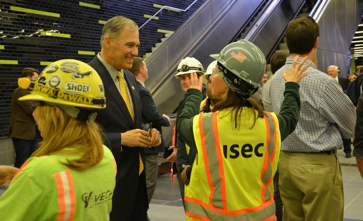 <em>Gov. Inslee visiting a new Sound Transit light rail station at the University of Washington on April 17, 2015.</em>