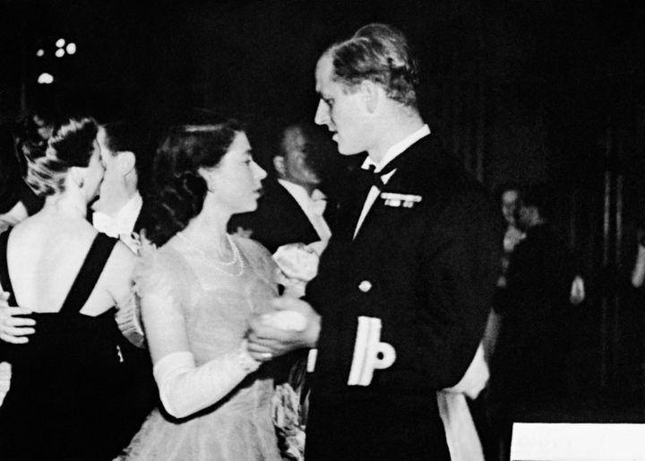 Princess Elizabeth dances with her then- fiancé, Lieutenant Philip Mountbatten,in July 1947.