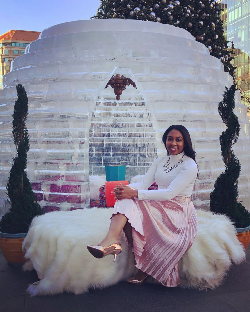 Ashley Simms is pictured celebrating the holidays at City Center in Washington, D.C.