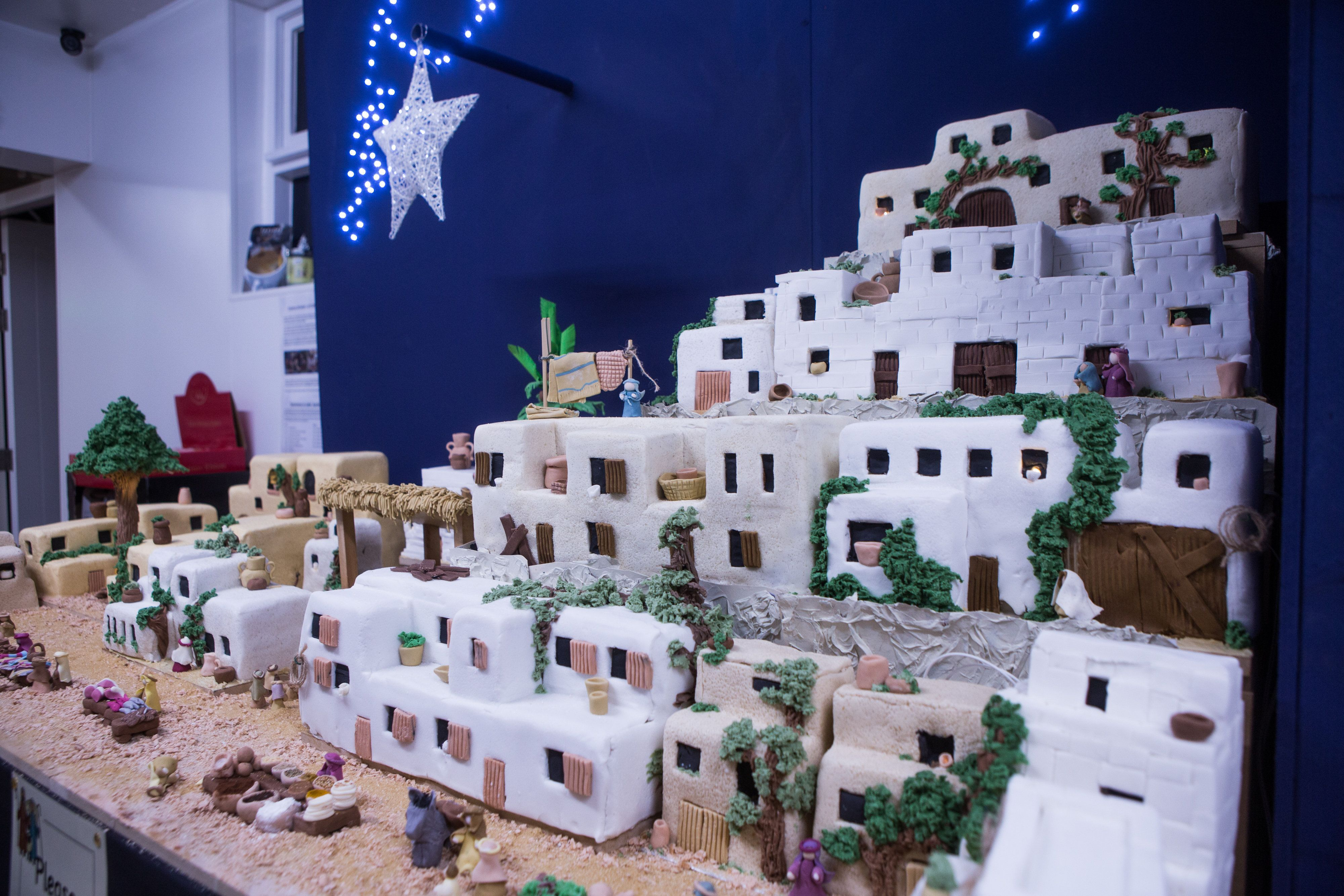 A giant nativity scene Christmas cake, comprising amongst other things, 110 pounds of marzipan, 1 gallon of whisky