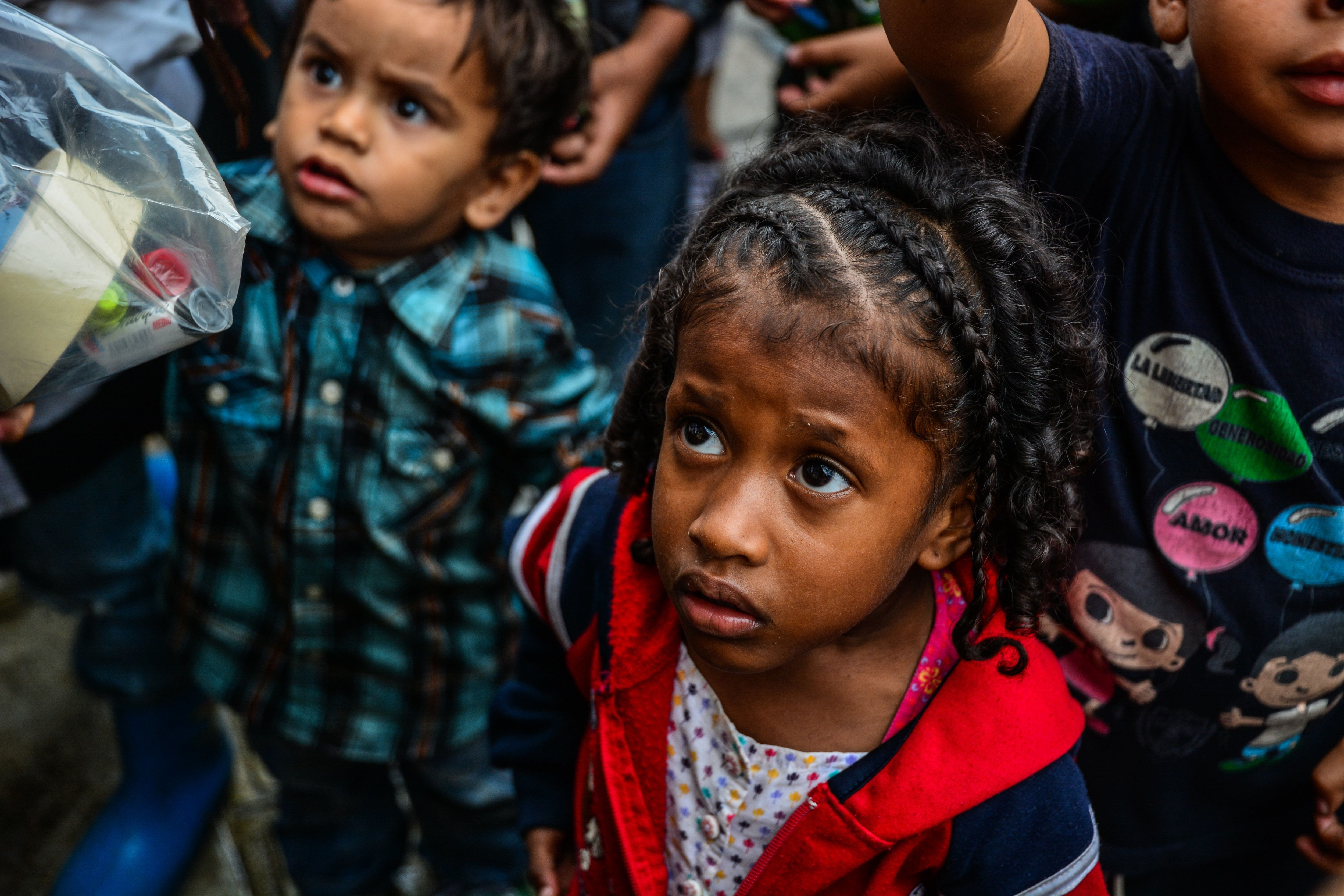 CARACAS, MIRANDA, VENEZUELA - 2017/11/05: Children wait for food in soup kitchens that provides free food on  the streets to counteract the food crisis Venezuela is going through. The country is experiencing its worst humanitarian crisis in years. (Photo by Roman Camacho/SOPA Images/LightRocket via Getty Images)